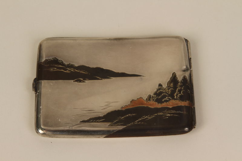 2001.283.4 back Sterling silver cigarette case with an etched Japanese landscape