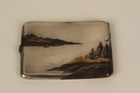 2001.283.4 back Sterling silver cigarette case with an etched Japanese landscape  Click to enlarge