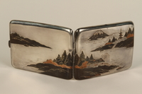 2001.383.4 exterior Sterling silver cigarette case with an etched Japanese landscape  Click to enlarge