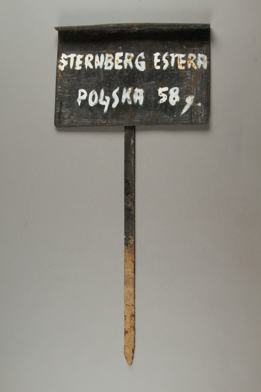 2012.319.4 front Metal grave marker of a Jewish woman who was killed in Djakovo labor camp