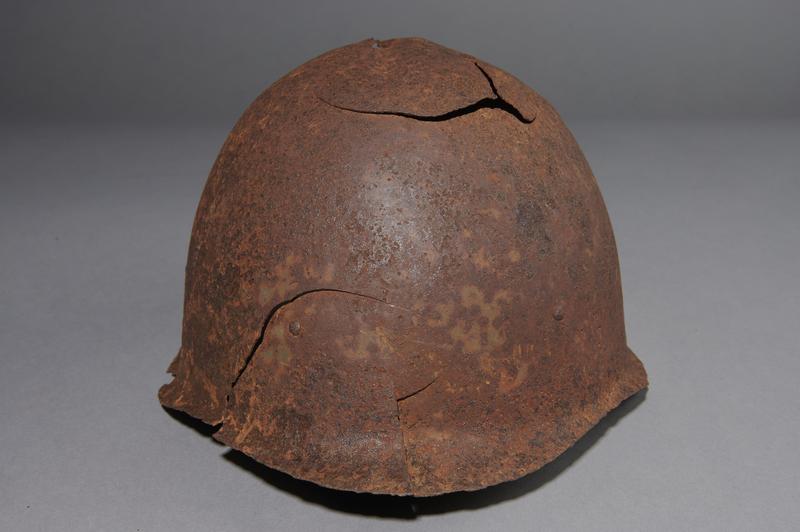 2013.170.1 front Damaged Soviet Army Ssh40 combat helmet recovered postwar in Latvia