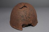 2013.170.1 back Damaged Soviet Army Ssh40 combat helmet recovered postwar in Latvia  Click to enlarge