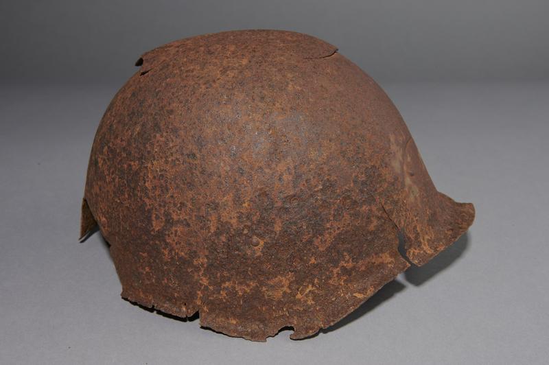2013.170.1 right Damaged Soviet Army Ssh40 combat helmet recovered postwar in Latvia