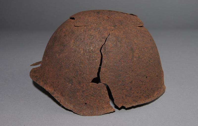 2013.170.1 left Damaged Soviet Army Ssh40 combat helmet recovered postwar in Latvia