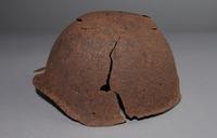 2013.170.1 left Damaged Soviet Army Ssh40 combat helmet recovered postwar in Latvia  Click to enlarge