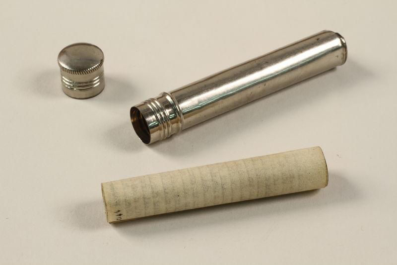2002.140.3 open Tubular silver mezuzah saved with a hidden Dutch Jewish infant