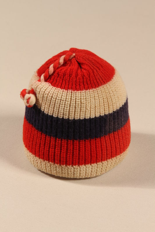 2002.140.4 front Child's striped knit wool cap with a tassel made for a hidden Dutch Jewish child