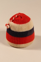 2002.140.4 front Child's striped knit wool cap with a tassel made for a hidden Dutch Jewish child  Click to enlarge