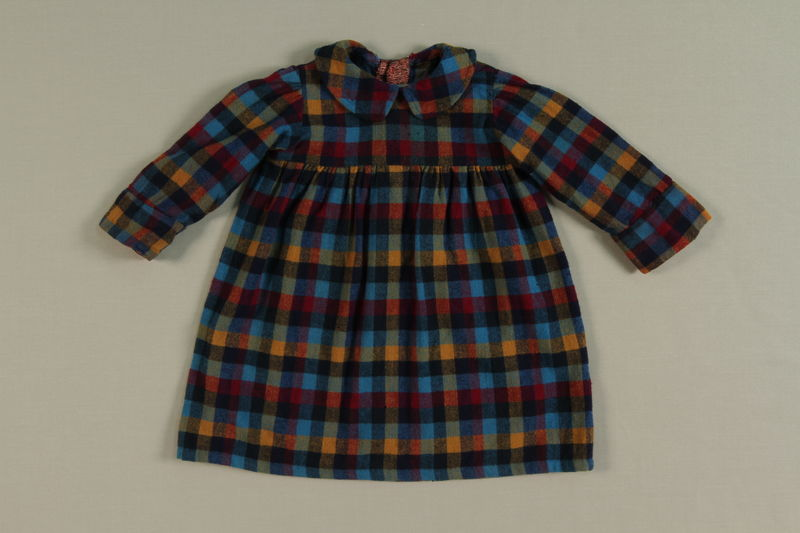 2002.140.7 front Colorful plaid dress worn by a hidden Dutch Jewish infant