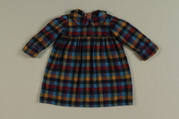 2002.140.7 front Colorful plaid dress worn by a hidden Dutch Jewish infant  Click to enlarge