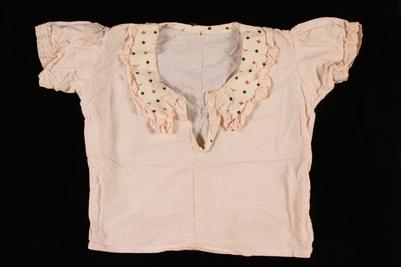 2002.140.8_a front Light pink pajama set worn by a hidden Dutch Jewish infant