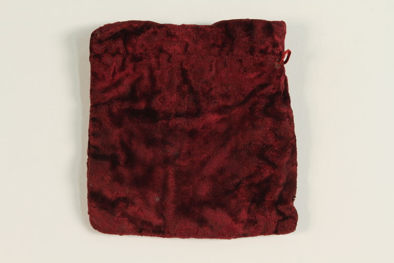 2002.140.12 front Dark red velvet square tefillin pouch saved with a hidden Dutch Jewish infant