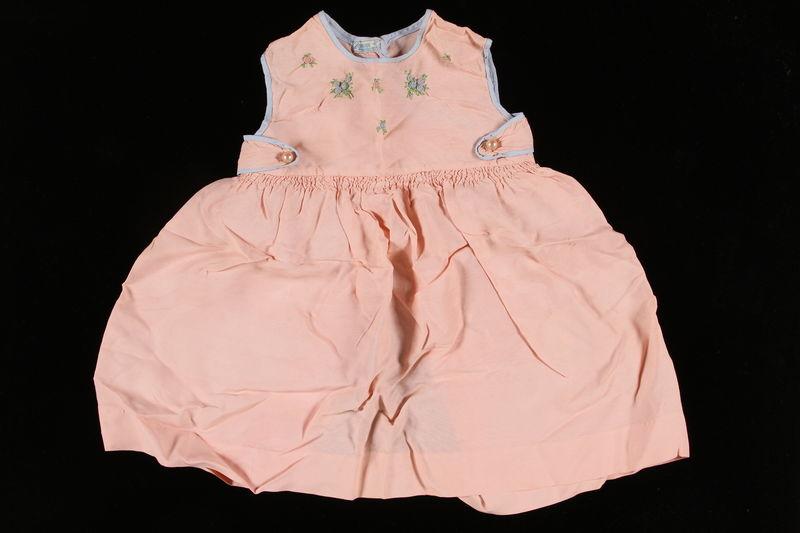 2002.140.15 front Light pink sleeveless dress worn by a hidden Dutch Jewish infant