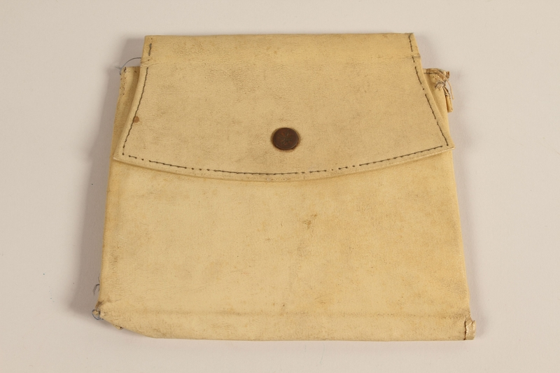 2002.140.16 front Ivory colored leather purse saved with a hidden Dutch Jewish infant