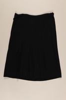 2002.223.1 front Hand sewn navy blue skirt with a pleated front made by a German Jewish woman  Click to enlarge