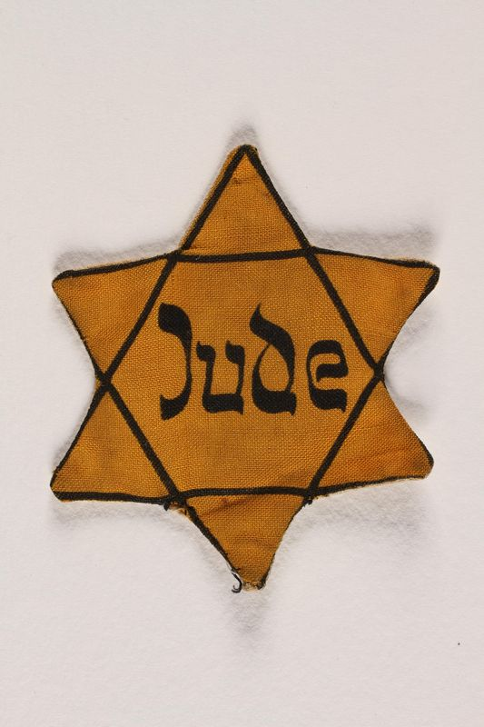 2002.204.2 front Star of David badge with Jude printed in the center