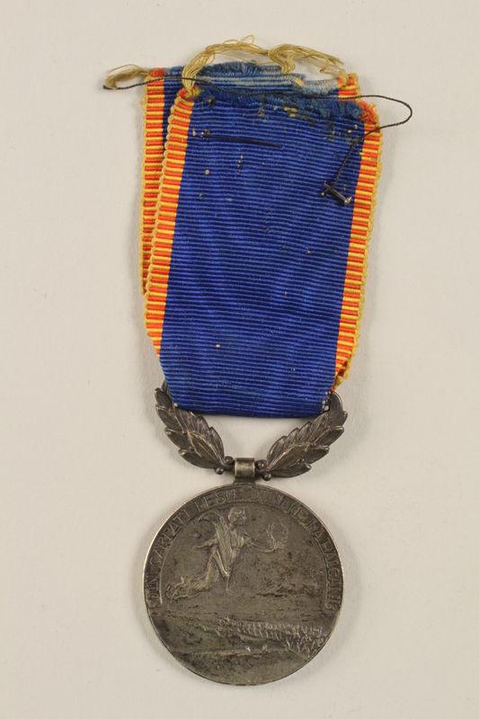 2002.224.3 back Medal