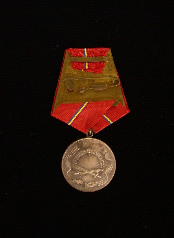 Medal with accompanying certificate of authenticity