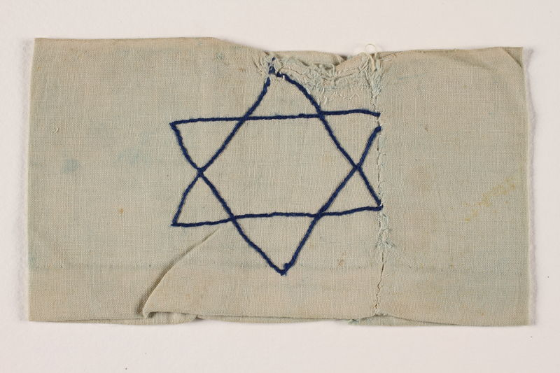2002.246.2 front Armband with an embroidered blue Star of David worn in the Bobrka ghetto