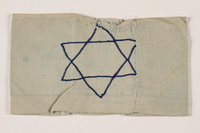 2002.246.2 front Armband with an embroidered blue Star of David worn in the Bobrka ghetto  Click to enlarge