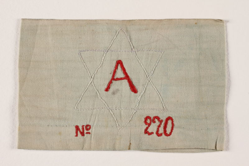 2002.246.3 front Armband with an embroidered white Star of David worn in the Bobrka ghetto