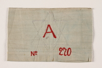 2002.246.3 front Armband with an embroidered white Star of David worn in the Bobrka ghetto  Click to enlarge