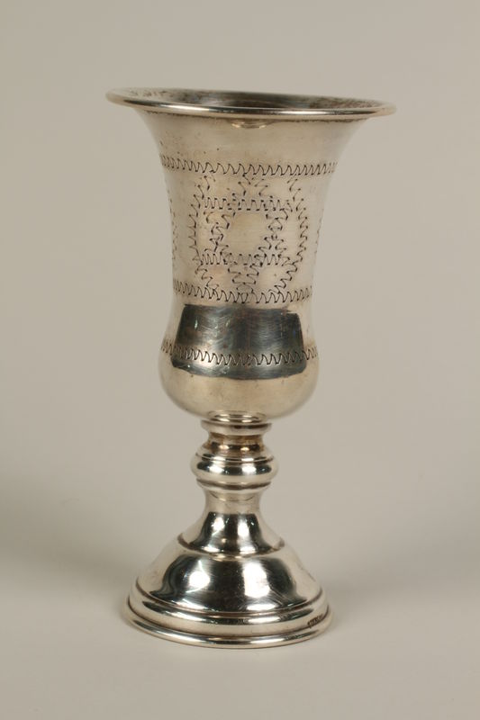 2002.250.2 front Silver, engraved kiddush cup used by German Jewish refugees in Shanghai