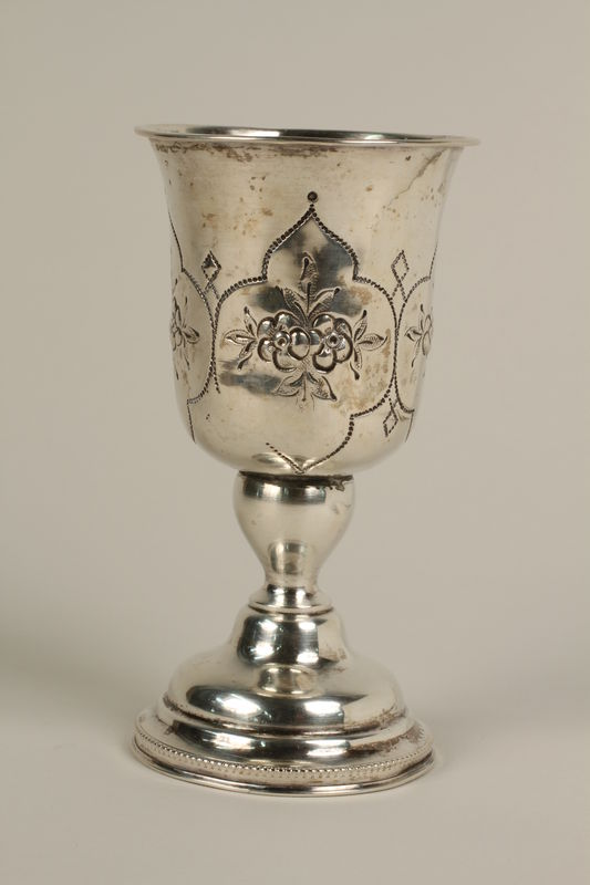 2002.250.3 front Silver, engraved kiddush cup used by German Jewish refugees in Shanghai