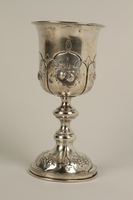 2002.250.4 front Silver, engraved kiddush cup used by German Jewish refugees in Shanghai  Click to enlarge
