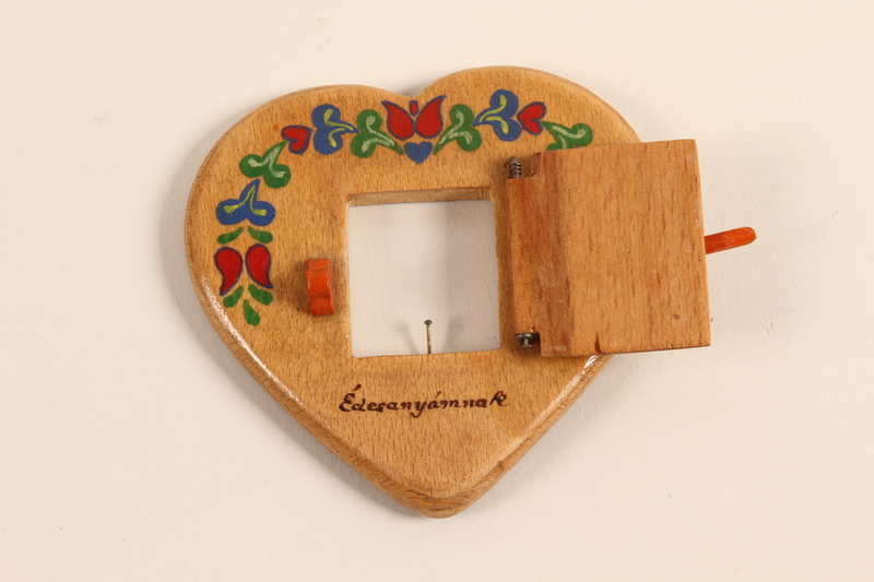 2001.311.3 front Heart shaped picture frame made by a girl for her mother