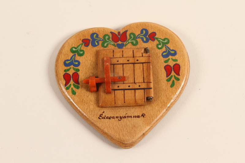 2001.311.3 closed Heart shaped picture frame made by a girl for her mother