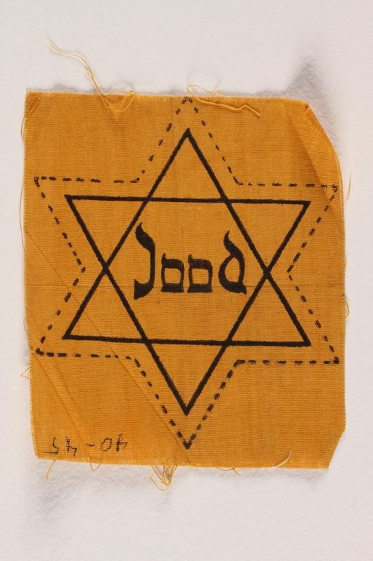 2002.299.2 front Star of David badge with Jood printed in the center