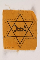 2002.299.2 front Star of David badge with Jood printed in the center  Click to enlarge