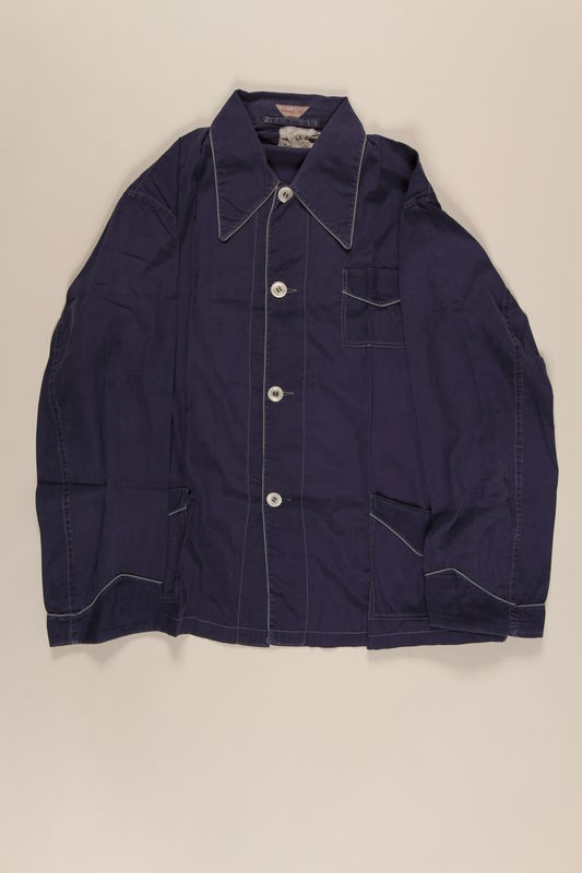 2001.3.2 front Man's dark blue pajama shirt given to a Czech Jewish inmate of Theresienstadt by another inmate