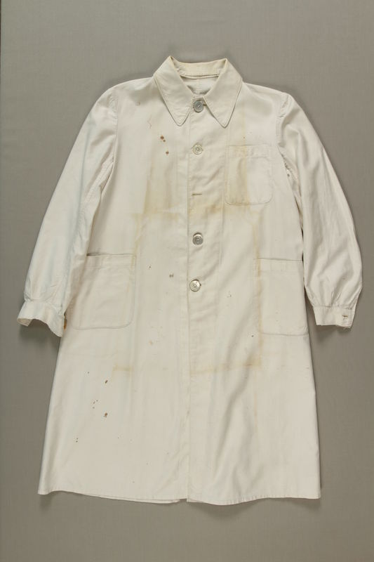 2001.3.3 front Woman's lab coat owned by a Czech Jewish inmate while a nurse in Theresienstadt