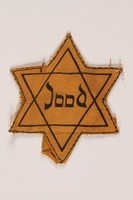 2002.357.2 front Star of David badge with Jood printed in the center  Click to enlarge