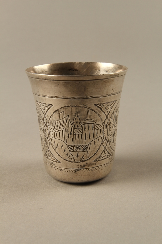 2003.41.1 front Silver kiddush cup with scenes of Lublin entrusted to a Gentile neighbor
