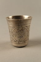 2003.41.1 back Silver kiddush cup with scenes of Lublin entrusted to a Gentile neighbor  Click to enlarge