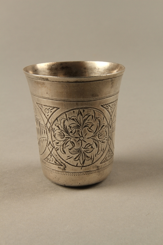 2003.41.1 left Silver kiddush cup with scenes of Lublin entrusted to a Gentile neighbor
