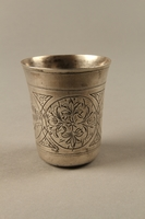 2003.41.1 left Silver kiddush cup with scenes of Lublin entrusted to a Gentile neighbor  Click to enlarge