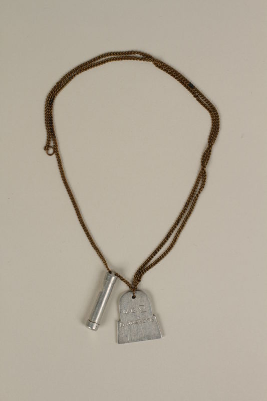 2003.64.2 front Mezuzah and tombstone pendants on a necklace made by a former concentration camp inmate in a DP camp