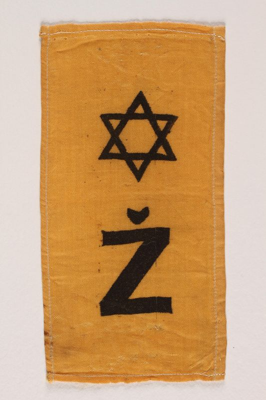 2002.432.2 front Rectangular yellow badge with Star of David and Ž kept by hidden child