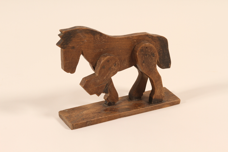 2002.433.1 a front Wooden horse and wagon pull toy