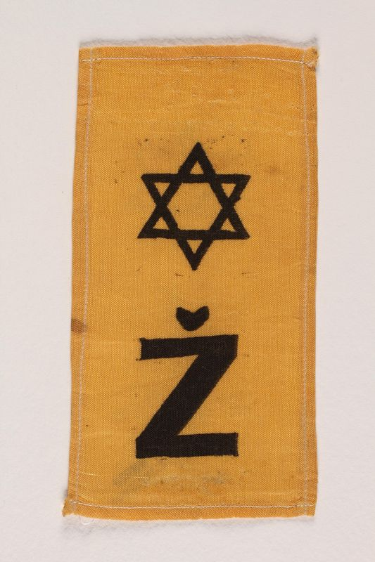 2002.432.3 front Rectangular yellow badge with Star of David and Ž kept by hidden child