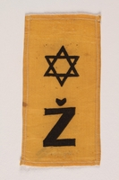 2002.432.3 front Rectangular yellow badge with Star of David and Ž kept by hidden child  Click to enlarge