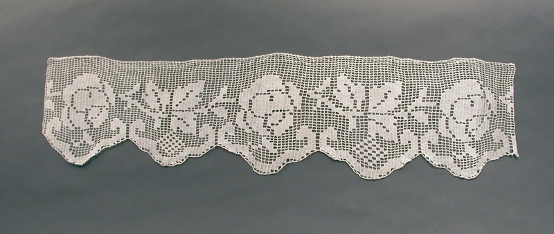 2003.113.1 front Floral patterned crocheted doily given to a Jewish Hungarian woman by a friend
