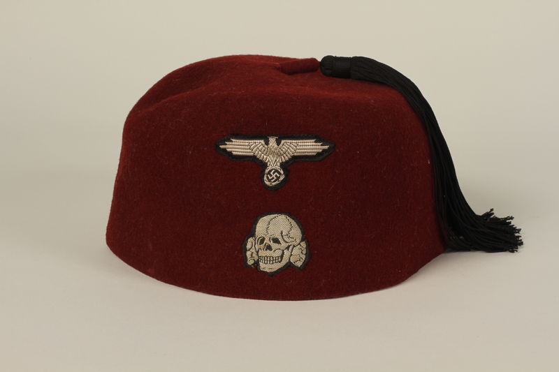 2003.173.1 front Waffen SS red fez acquired by a US soldier