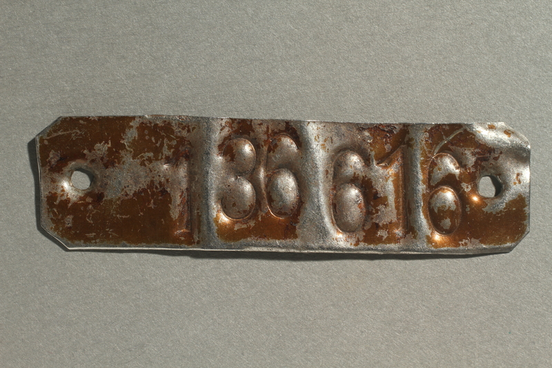 2002.446.1 front Metal tag with her stamped prisoner number worn as a bracelet by a concentration camp inmate
