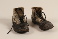 2002.447.1 a-b front Pair of toddler's well used black and white leather lace-up boots worn in Theresienstadt ghetto/labor camp  Click to enlarge