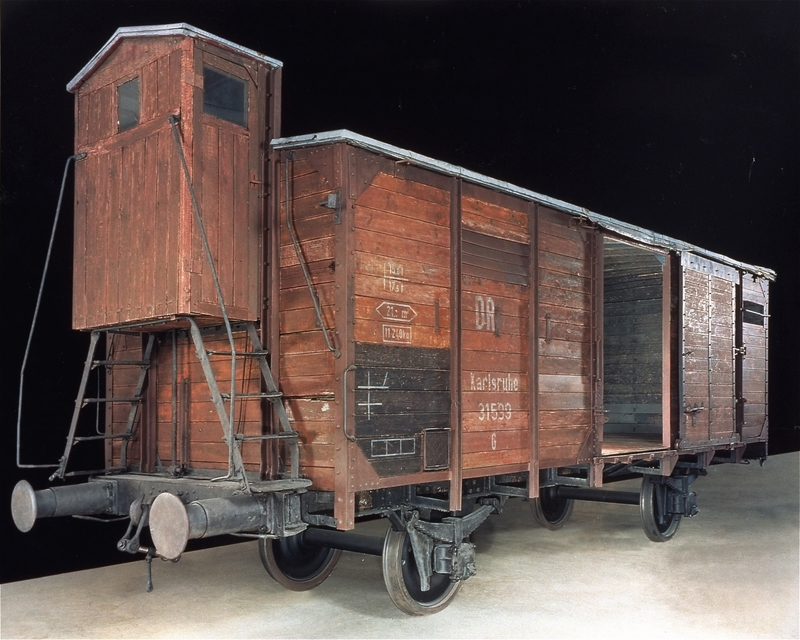 1989.225.1 Double-door railroad freight car with brakeman's cabin of the type used to transport victims throughout the Nazi camp system